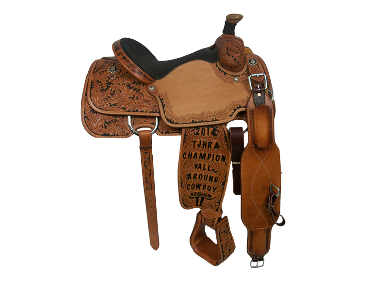 Saddle Details:  Traditional Patterns.  7/8 Oak with Black Dyed Background.  Tooled Stirrups to Match.  Oak Border with Dyed Background in Seats.  Braided Horn Knot.  Rust Conchos.