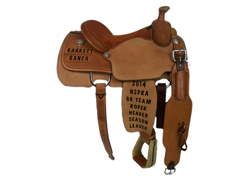 Saddle Details:   Traditional Patterns.  1/4 Geometric.  Rough Out Skirts, Seats, and Fenders.  Rawhide Roper Stirrups.  Rust Suede Seat. Silver Dollar Conchos.