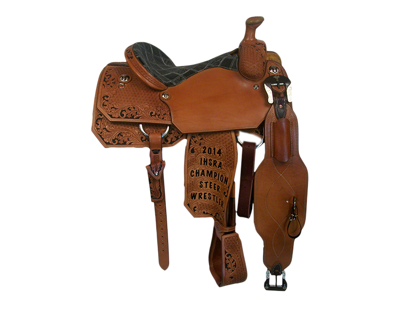 Saddle Details:  Angle Cut Patterns.  7/8 Geometric.  7/8 Floral Border with Black Dyed Background.  Tooled Stirrups to Match.  Rust Conchos and Flank Buckles.  Patchwork Seat. Hoof Pick Pocket on Offside Billet.