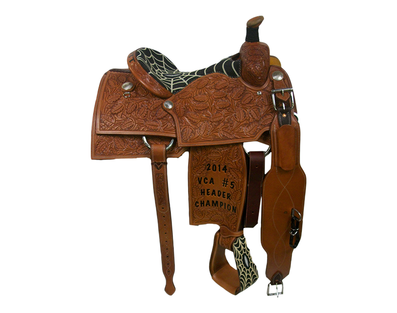 Saddle Details:  Square Cut Patterns.  Full Oak.  Black Spiderweb Stingray Seat and Matching Stirrups.  Silver Dollar Conchos.  Braided Horn Knot.
