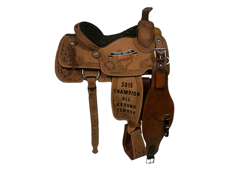 Saddle Details:   Traditional Patterns.  All Rough Out.  Full Deluxe San Carlos Border (Floral and Serpentine) with Chocolate Dyed Background. Quilted Black Suede Seat.  Rawhide Horn Edge.  Stirrups Tooled to Match.  Berry Edge Conchos.