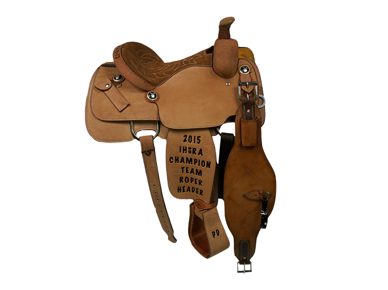Saddle Details:   Traditional Patterns.  All Rough Out.  Quilted Rust Suede Seat.  Hoof Pick Pocket on Housing.  Rust Conchos.  Rawhide Horn Edge.