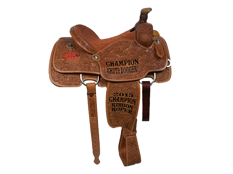 Saddle Details:  Traditional Cut Patterns.  Full Post Oak.  Quilted Rust Suede Seat.  Dollar Sign Rust Conchos.  Rawhide Horn Edge.  Stirrups Tooled To Match.