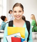 20772279-happy-student-girl-with-school-bag-and-notebooks-at-school.jpg