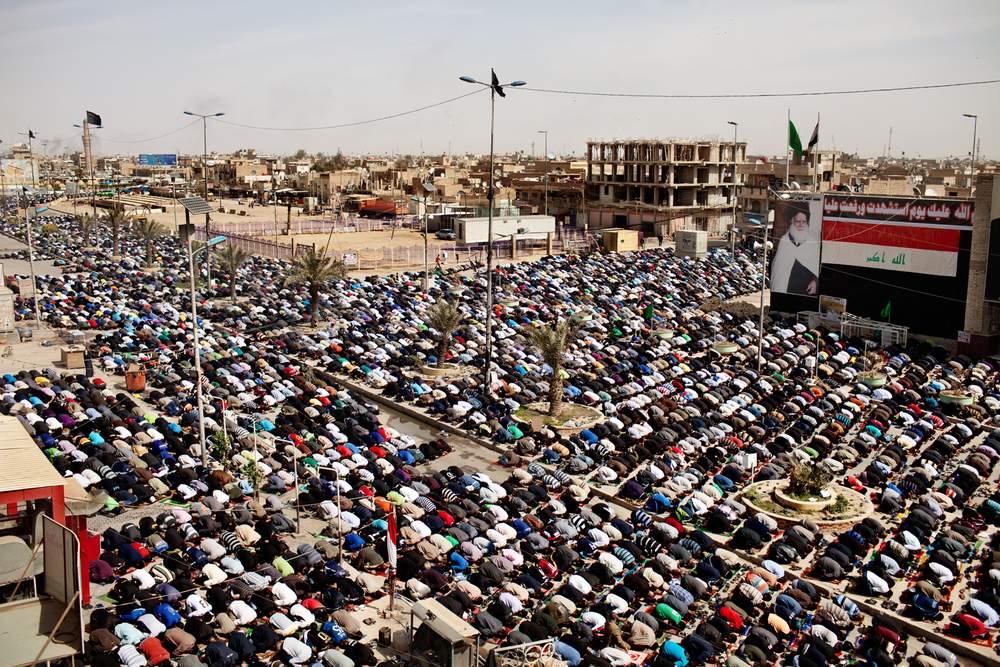 Shiite Muslims gather in the street for Friday prayer in Sadr City, Baghdad, Iraq.