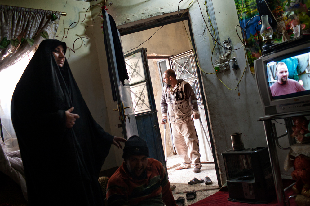 Hassab Abad Jabad stands in the doorway of his home in Baghdad, Iraq. Hassab lost his right leg in an attack targeting Shiite pilgrims travelling to Najaf.
