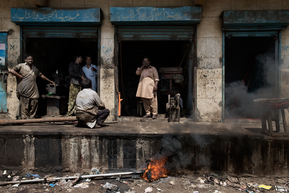 A boat workshop during load-shedding in Madir Town, Karachi, Pakistan.