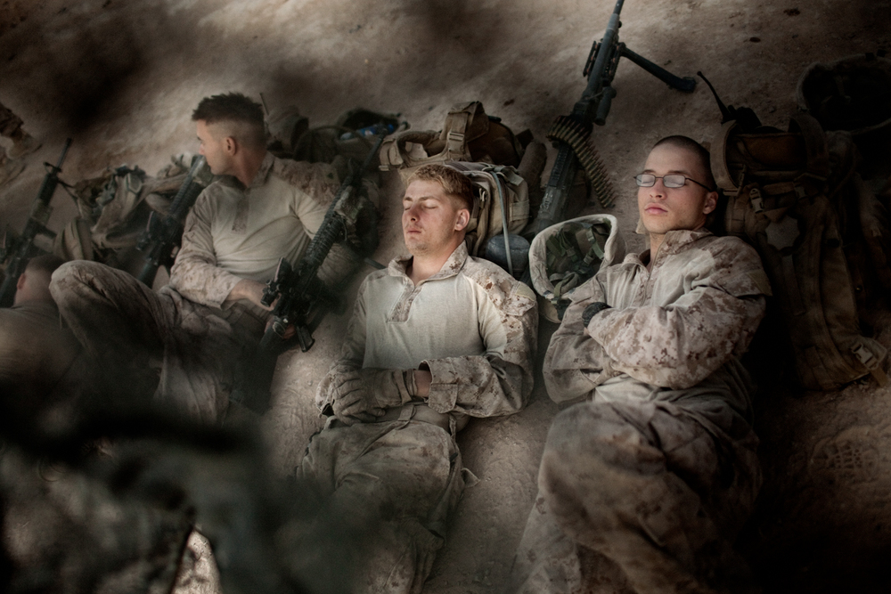 U.S. Marines rest at Combat Operations Post Coutu before a patrol in Marja District, Helmand Province, Afghanistan.