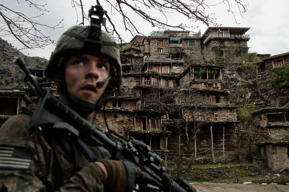 U.S. Army soldiers patrol through Loi Kolay village in the Korengal Valley, Kunar Province, Afghanistan.
