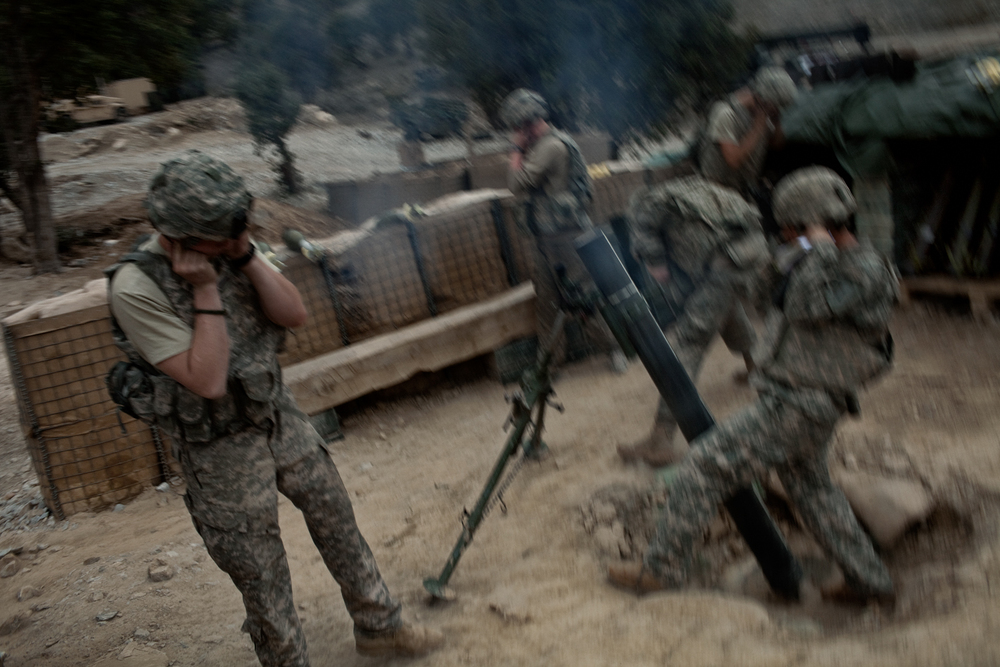 U.S. Army soldiers fire mortars to support a patrol at the Korengal Outpost, Kunar Province, Afghanistan.