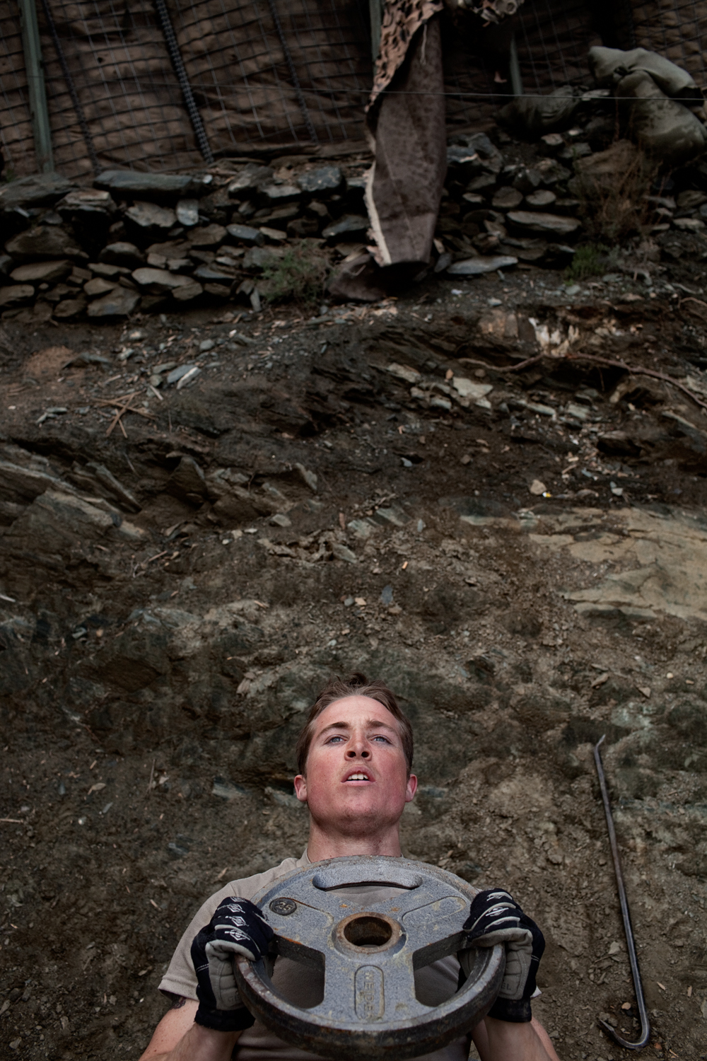 A U.S. Army soldier works out at Observation Post Dallas in the Korengal Valley, Kunar Province, Afghanistan.