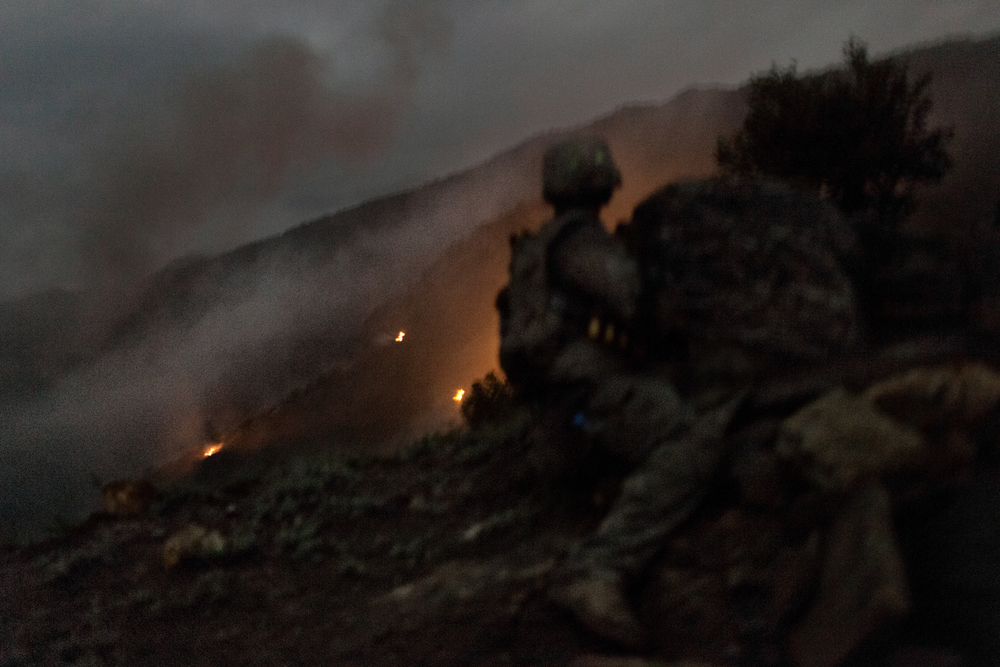 A U.S. Army soldier takes cover during fighting with insurgents in the Korengal Valley, Kunar Province, Afghanistan.