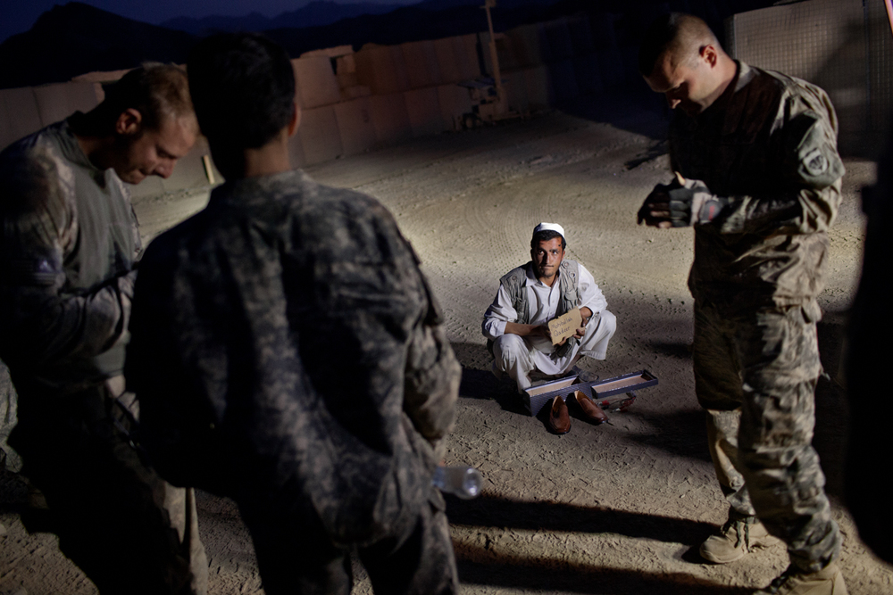 An Afghan man is detained by U.S. Army at Combat Operations Post Tangi, Wardak Province, Afghanistan.