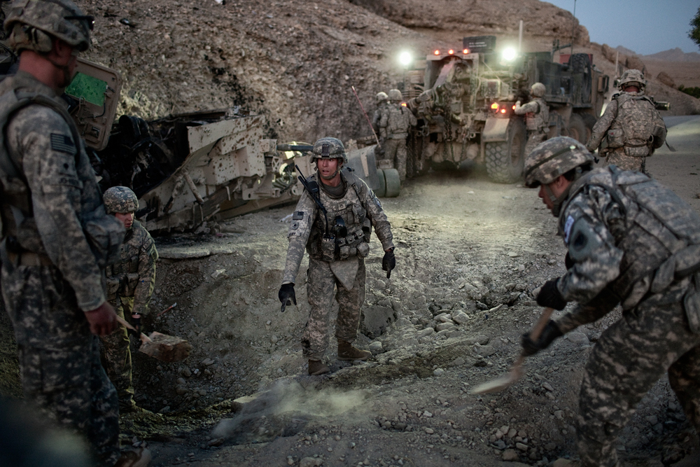 U.S. Army soldiers clear a road after an improvised explosive device attack on a vehicle in the Tangi Valley, Wardak Province, Afghanistan.