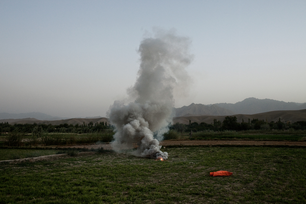 A flare marks a landing zone for medical evacuation helicopters after three U.S. Army Soldiers were injured in an improvised explosive device attack in the Tangi Valley, Wardak Province, Afghanistan.