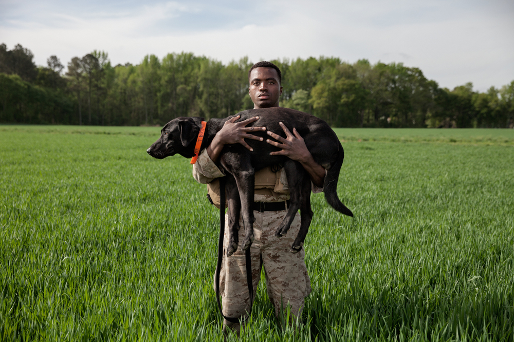 Marine Corporal Dashno Villard with explosives detector dog Bank, North Carolina, U.S.A. Photo by Adam Ferguson for National Geographic