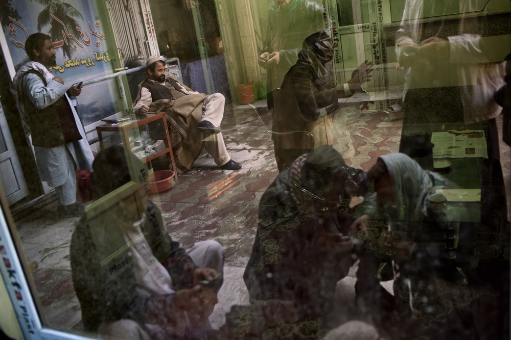Afghan money changers and customers do business in the Sarai Shahzada Money Market in Kabul, Afghanistan, 2010. Photo by Adam Ferguson