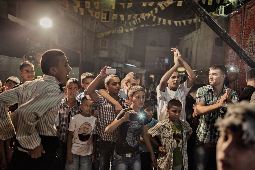 A crowd gathers for a wedding party at the Shuafat refugee camp, Jerusalem, Israel.
