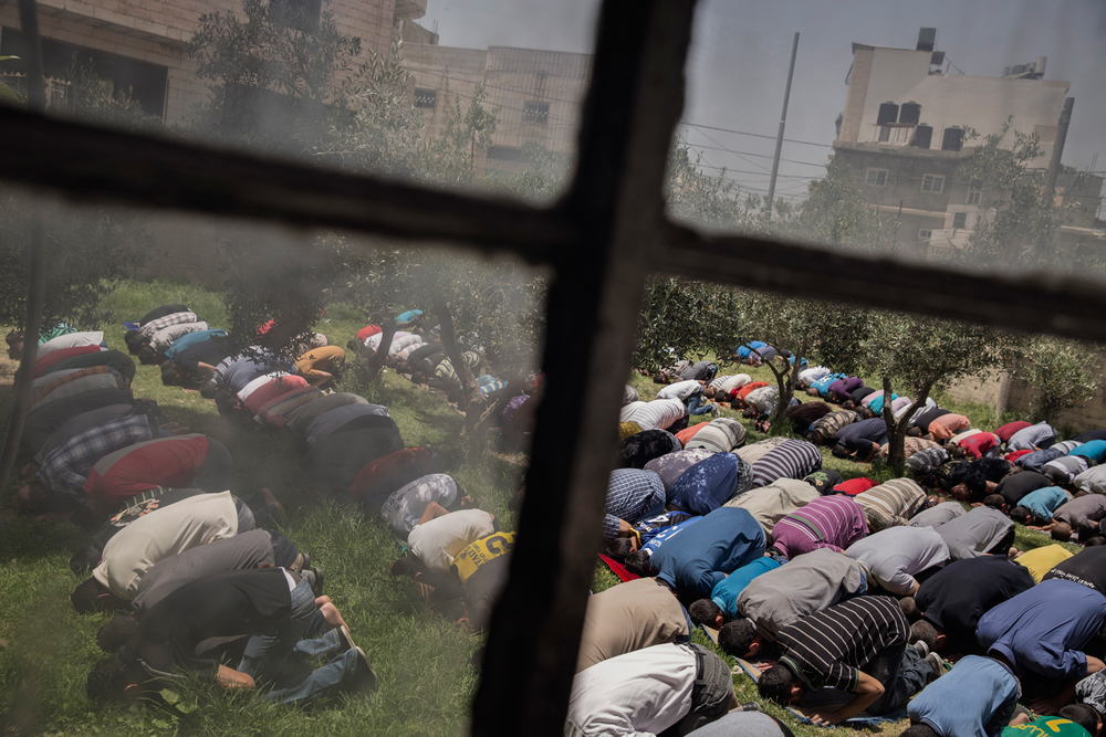 Men and boys attend midday prayer at a mosque inside Al-Arroub refugee camp in Hebron, West Bank, Palestinian Territories.