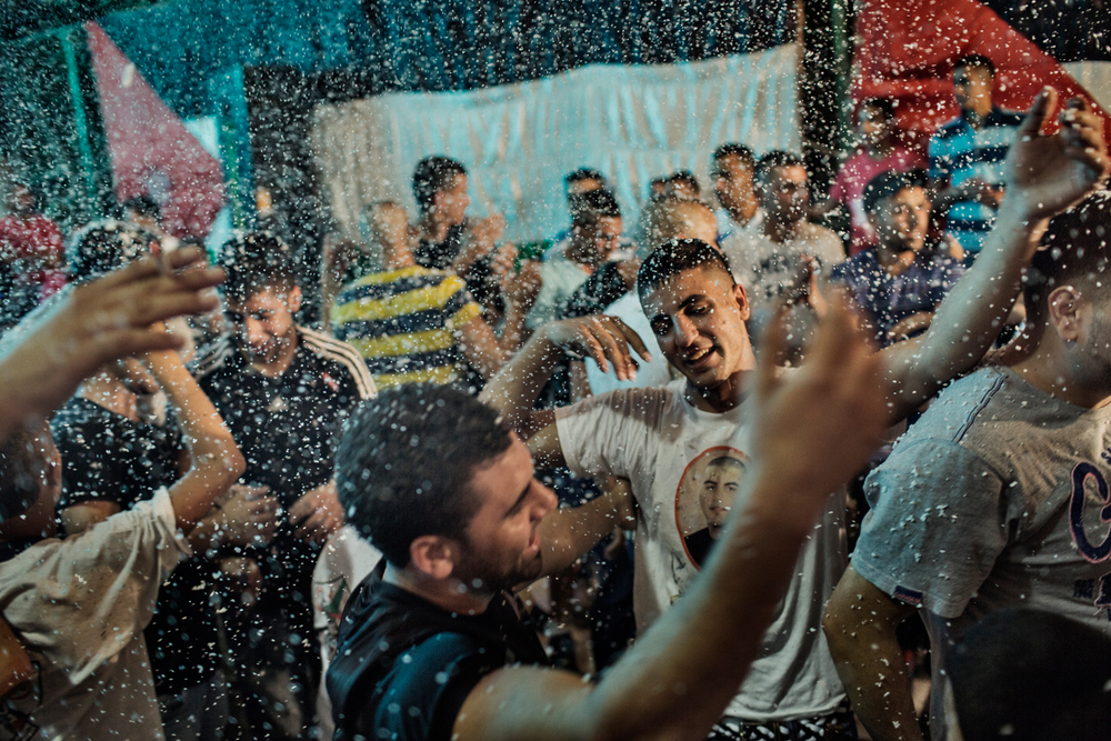Palestinian men dance at a wedding party at Shuafat refugee camp in Jerusalem, Israel.