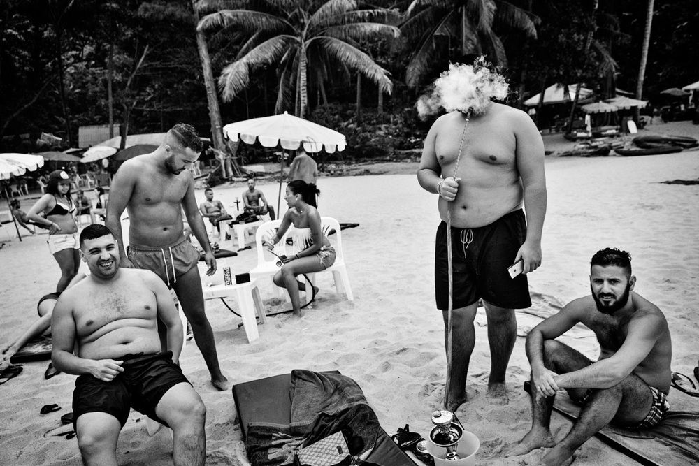 A group young French Muslim tourists socialise a beach in Phuket, Thailand on Feb. 18, 2015. Photo by Adam Ferguson