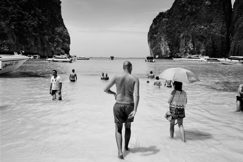 Mourad Kateb (C), age 23, from a Banlieue in Paris, France, on the beach at Ko Phi Phi Lee Island in Phuket, Thailand on Feb. 19, 2015. Kateb is Muslim and is travelling with his younger cousin in Thailand. Photo by Adam Ferguson