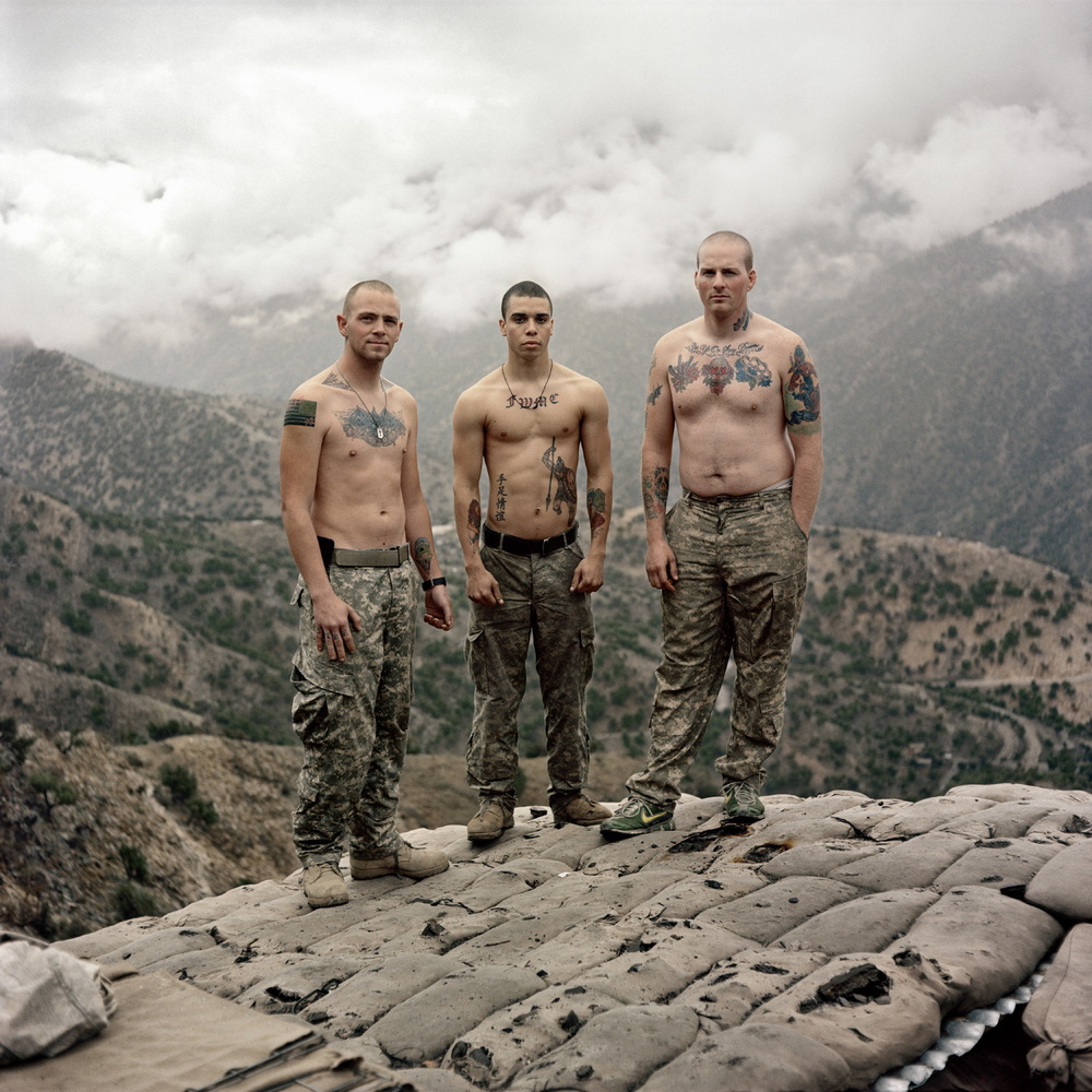 U.S. Army soldiers from Bravo Company of the 26th Infantry Regiment of the 1st Infantry Division stand for a portrait at Fire Base Restrepo in the Korengal Valley, Afghanistan.