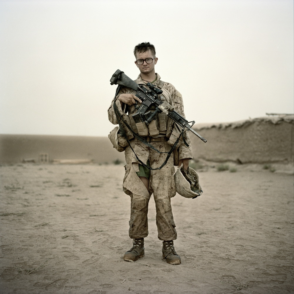 A U.S. Marine from Lima Company of the 3rd Battalion 6th Marines stands for a portrait after finishing a patrol out of at Combat Operations Post Coutu in Marja District, Helmand Province, Afghanistan.