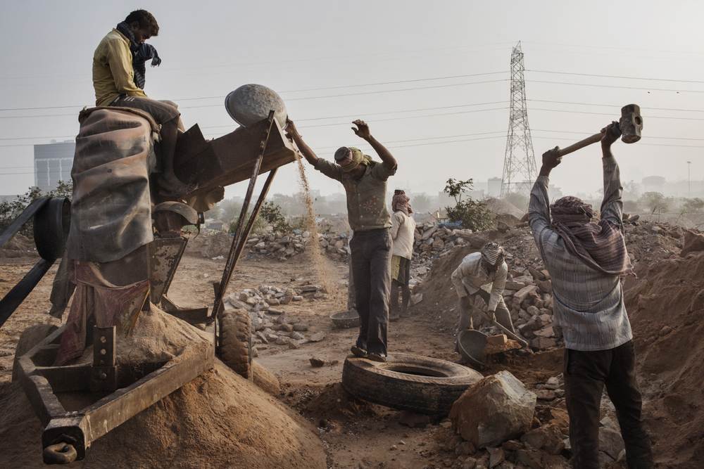'Illegal Sand Mining, India' for  WIRED :  Indian workers crush stone into sand at an Illegal mine near Raipur Village in Greater Noida, Uttar Pradesh, India.