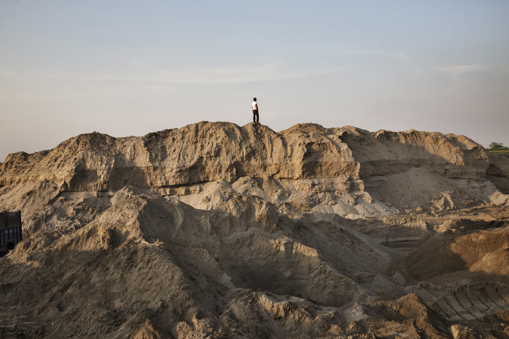 A view of an illegal sand mine on the bank of the Yamuna River in Greater Noida, Uttar Pradesh, India.