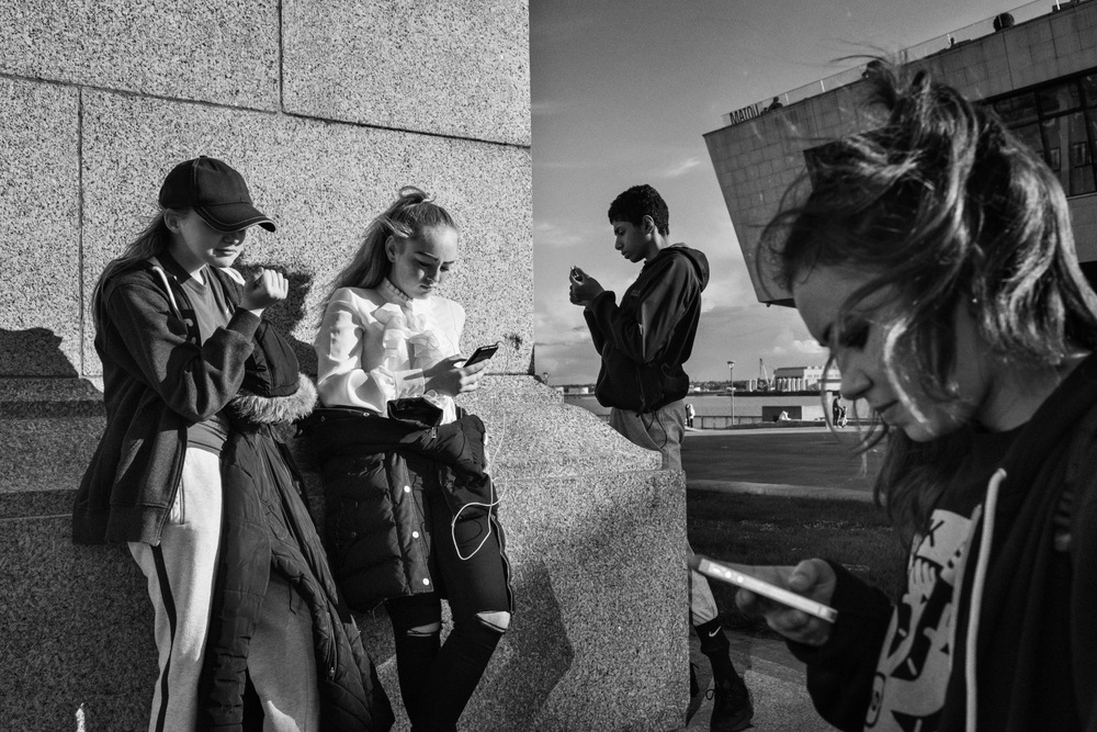 Teenagers from Liverpool interact in a park at the Liverpool Cruise Terminal port in Liverpool, United Kingdom.