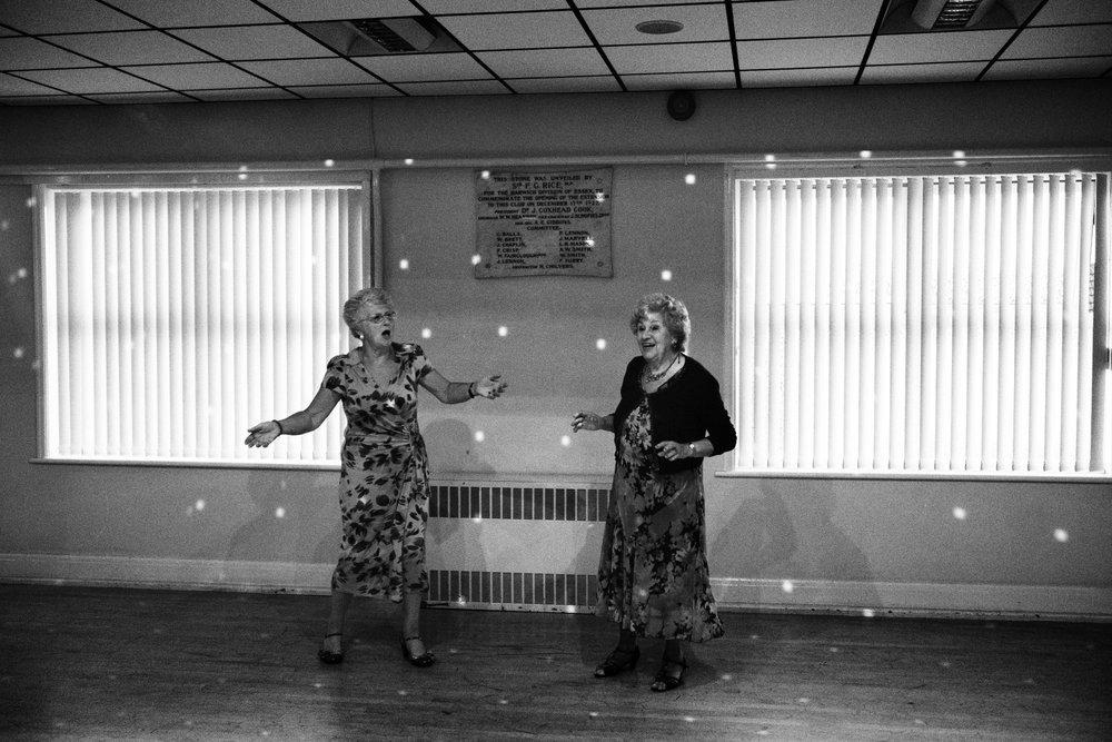 Elderly English women dance at the Conservative Club in Clacton-on-Sea in Essex, England, United Kingdom, 2016.