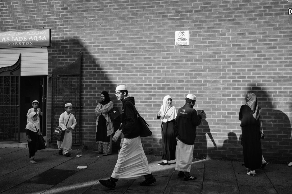 Children leave the Masjade Aqsa in Preston, York, United Kingdom, 2016.