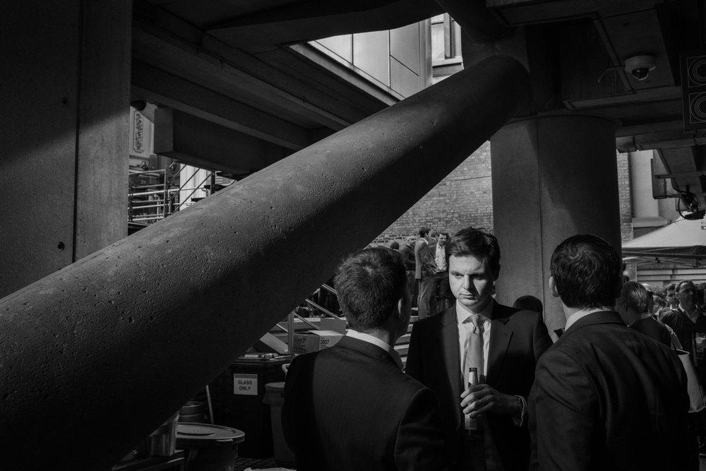 White collar workers have afternoon drinks at a bar in the heart of the Financial District in London, United Kingdom, 2016.
