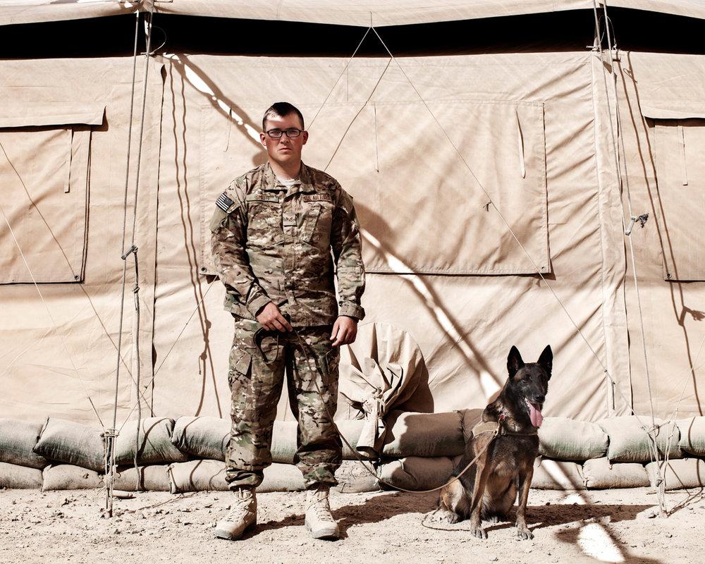 Senior Airman Erik Smith from 820th Base Defence Group, Moody Air Force Base Georgia and Military Working Dog Tara, a Belgian Malinois patrol explosives detection dog, Kandahar Airfield, Afghanistan, 2012.