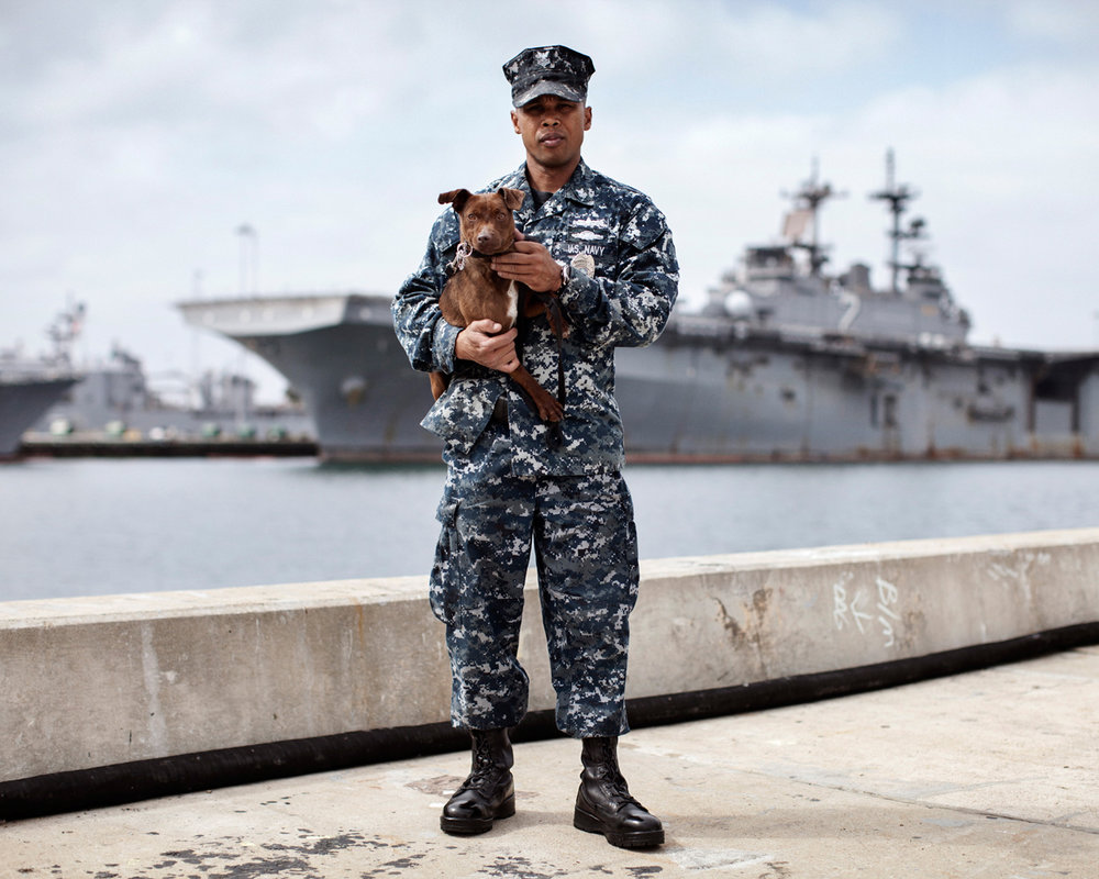 U.S. Navy Master at Arms Erwin Montoyo and Military Working Dog Crash, a Terrier single purpose narcotics detection dog, Naval Base San Diego, California, U.S, 2012.
