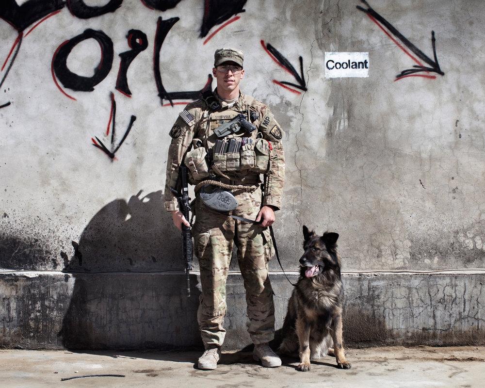 Sergeant Benjamin Stopyra and Military Working Dog Gero, a German Shepherd patrol explosives dog, Camp Nathan Smith, Kandahar, Afghanistan, 2012.