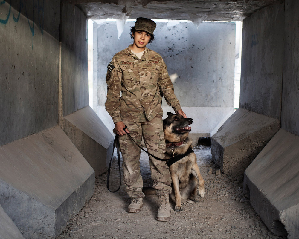 U.S. Army Staff Sergeant Kathelene Chambers and Military Working Dog Bartja, a patrol narcotics detection dog, Camp Nathan Smith, Kandahar City, Afghanistan, 2012.