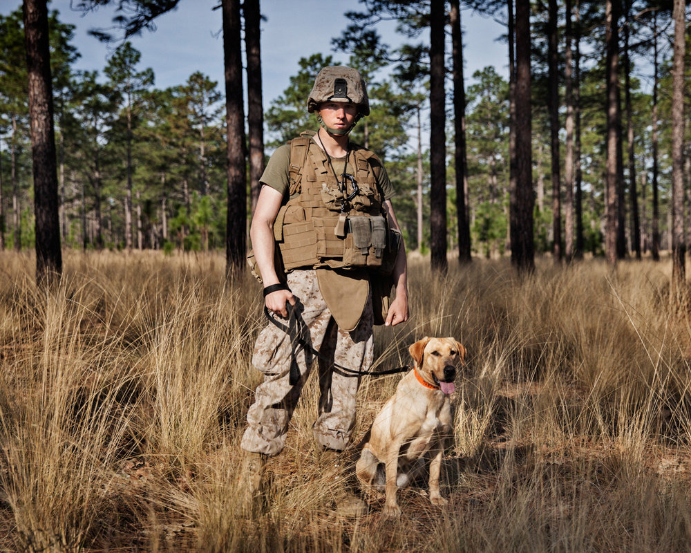 U.S. Marine Private First Class Jacob Guidry and Improvised Detection Dog Miley, K2 Solutions training course in Ellerbe, North Carolina, U.S, 2013.
