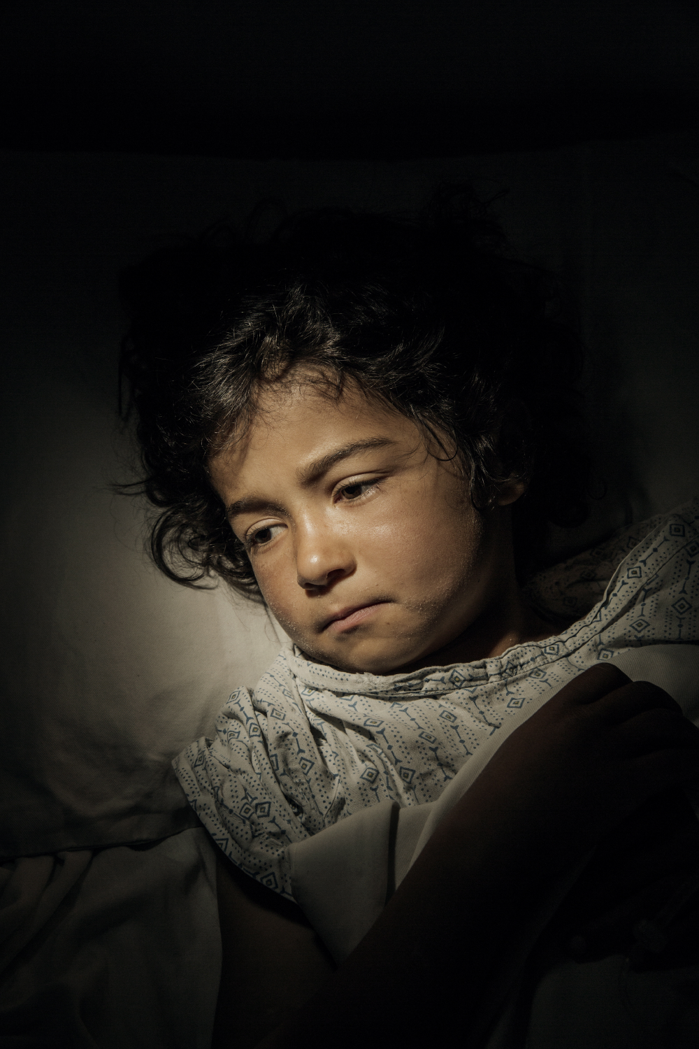 Bibi Najla, age 7, after being shot during fighting between Taliban and government forces in Logar Province, Afghanistan, 2015.