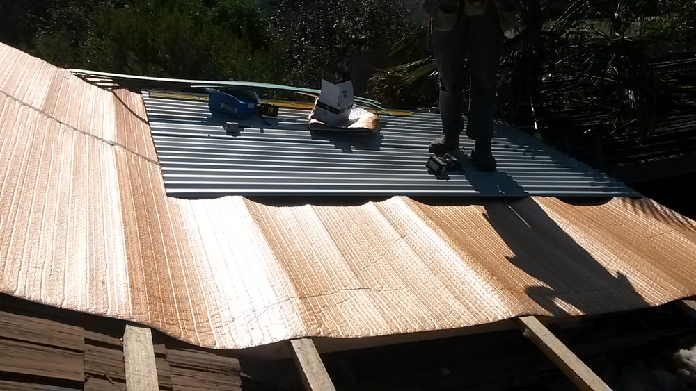 Aircell insulative sarking is draped over the roofing battens.