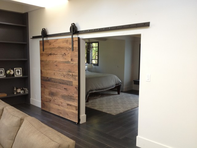 Wall-hung sliding barn door. All the cool kids are having one of these! Could be used for the Rumpus room, hung on the passage side, and at the end of the passage on the kitchen side.