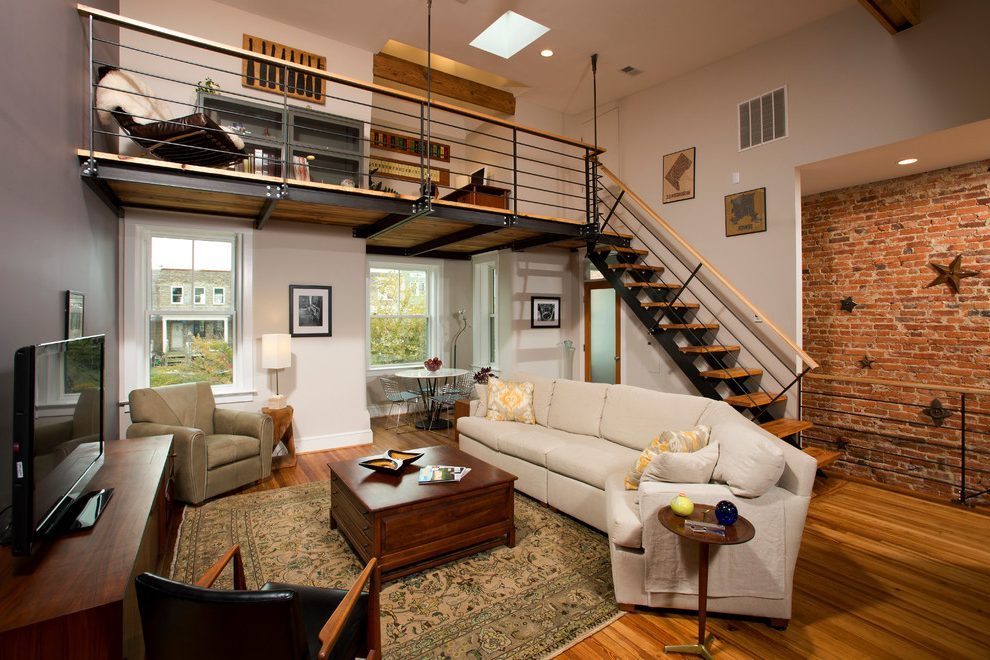 loft-layout-family-room-industrial-with-skylight-novelty-print-accent-and-garden-stools.jpg