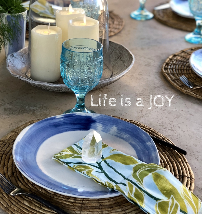 Zen blue circle of life in a silky white glaze. Each plate is hand glazed one by one and hand painted with a brush.