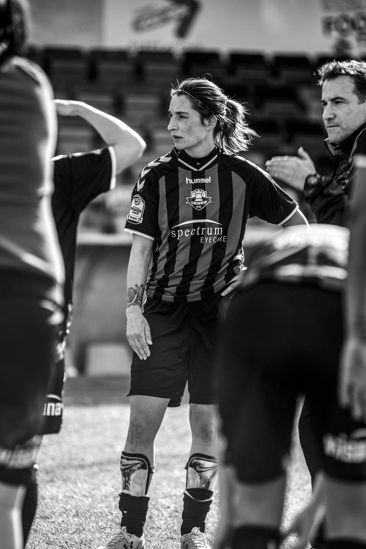Woman football looking serious.jpg