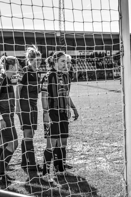 Women footballers waiting for a corner.jpg