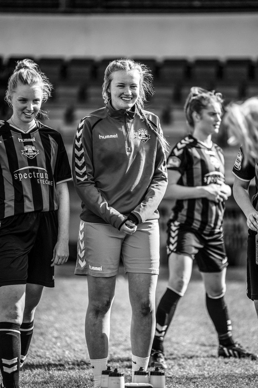 Pretty woman footballer smiling.jpg
