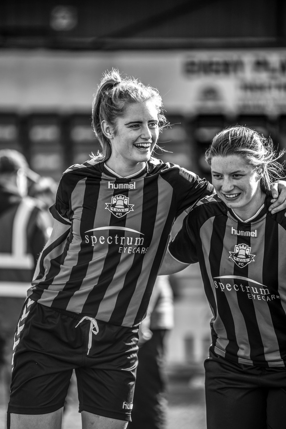 Two women footballers smiling.jpg