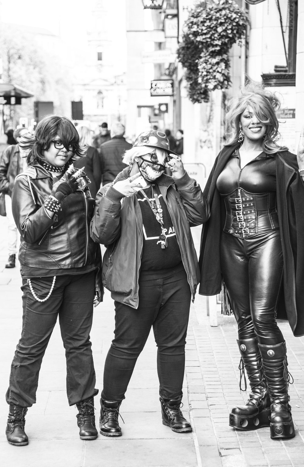 Three ladies in black leather in London.jpg