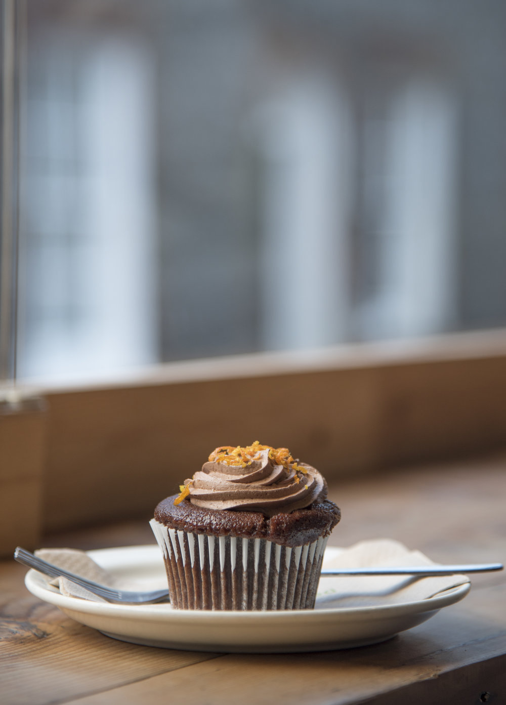 Chocloate and orange cupcake in cafe.jpg